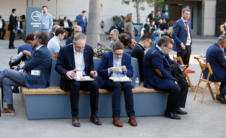 Barcelona, Spain - February 26, 2019 - Businessmen during lunch time during Mobile World Congress in Barcelona Editorial