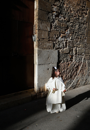 Palma de Mallorca, Spain - April 14 2019 - Penitents take part in the procession of Saint christ of Santa Cruz during easter holy week in the Spanish island Editorial