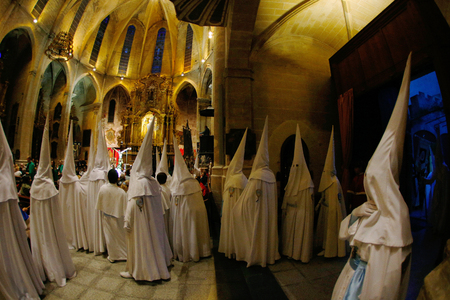 Palma de Mallorca, Spain - April 17 2019 - Penitents take part in the procession of Saint christ of Santa Cruz during easter holy week in the Spanish island Redactioneel
