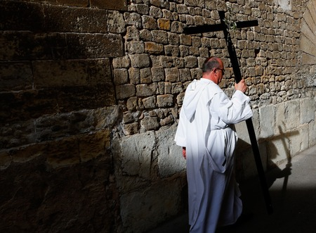 Palma de Mallorca, Spain - April 17 2019 - Penitents take part in the procession of Saint christ of Santa Cruz during easter holy week in the Spanish island