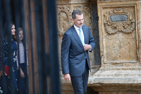 Palma de Mallorca, Spain - April 21 2019: The King of spain King Felipe followed by Queen Letizia and Princess Sofia leave Palma de Mallorca Cathedral after attending an easter sunday mass.