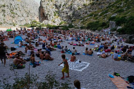 Calvia, Mallorca  Spain - July 7, 2019: People meet at the Torrent de Pareis area in the north coast of the island of Mallorca to watch a classic choral concert each first week of july sice decades