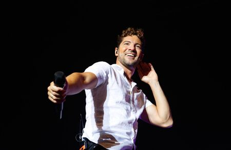 Calvia, Mallorca / Spain- August 31, 2019: Spanish singer David Bisbal performs live during his 2019 promotion tour near the village of Calvia in the island of Mallorca