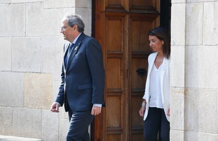 Barcelona/Spain - October 1 2019 -The president of Catalonia Quim Torra, followed by  Government Spokeswoman and Minister of the Presidency Meritxell Budo i Pla seen before the government of Catalonia speaks before receiving the sentence of the Spanish co