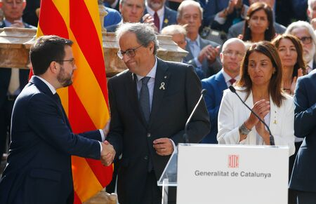 Barcelona/Spain - October 1 2019 -The President and Vicepresident of Catalonia Quim Torra (right) and  Pere Aragones shake hands next to other members of the Catalan government after their speech before receiving the sentence of the Spanish court against