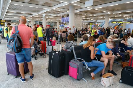 Palma de Mallorca / Spain - October 23, 2019: Passengers stranded in Palma de Mallorca airport after the major tour operator Thomas Cook failure causing many cancellations and large delays to passengers worldwide.