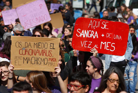 Palma de Mallorca / Spain - March 8, 2020: Women march wearing banners and shouting slogans during the Internationa Women Day (8th March) in Palma de Mallorca. Éditoriale