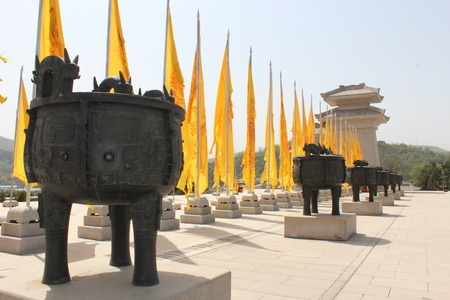 ding: Big ancient ding and yellow flags