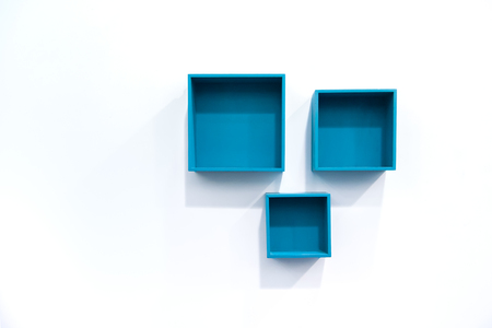 Blue Boxes Shelve on Wall