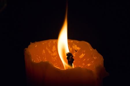 dark: Amazing beautiful Big candle light burning in the dark background