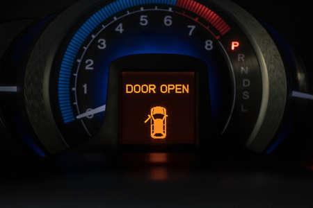 door open system warning icon on vehicle dashboard, car computer display Archivio Fotografico