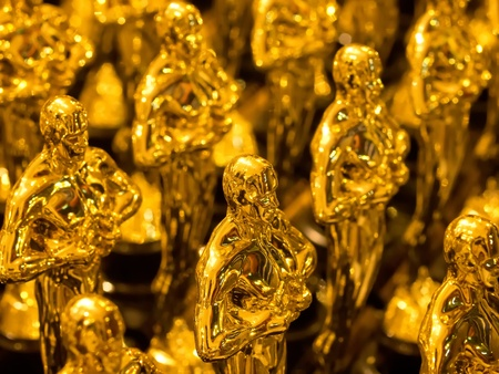 academy: array of golden statues Stock Photo