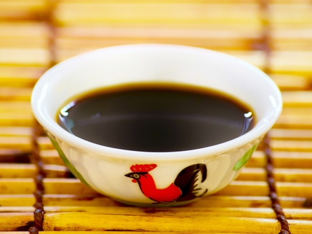 close up of a bowl of soy sauce