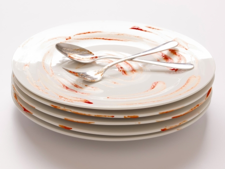 wash dishes: close up of a stack of dirty plates Stock Photo