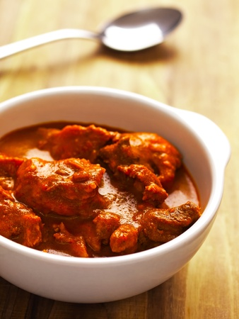 close up of a bowl of indian mutton curry photo