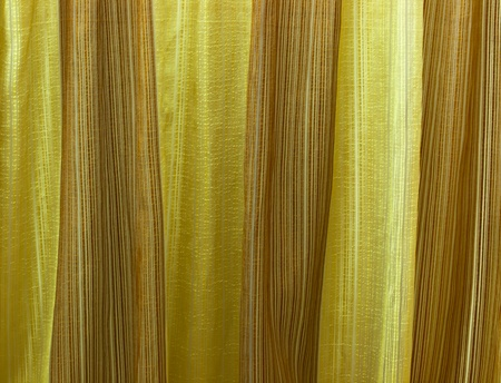 close up of gold colored fabric photo