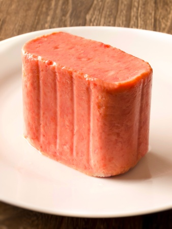 close up of a slab of spam on a plate photo