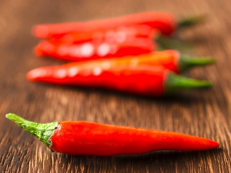padi: close up of red chili padi on table