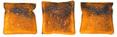 burnt toast: close up of burnt toast on white