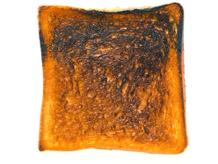 burnt toast: close up of a sliced of burnt toast Stock Photo