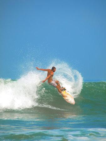 kuta: kuta beach, bali, indonesis, august 5, 2009 - surfing action at kuta beach