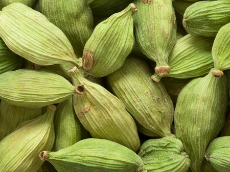close up of cardamon pods food background photo