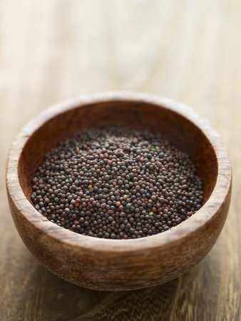 close up of a bowl of black mustard seeds photo