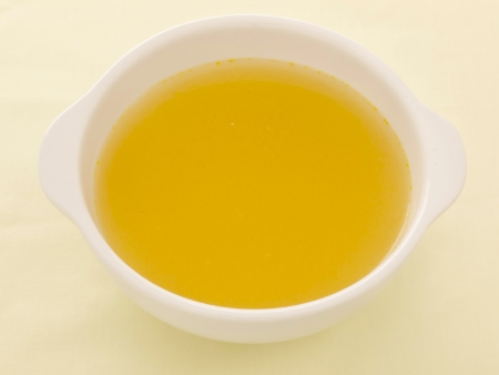 rich flavor: close up of a bowl of chicken broth