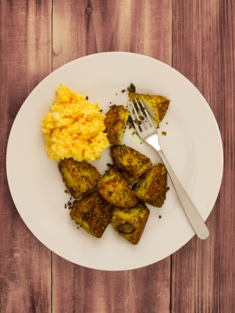 closeup of a plate of crusty baked potatoes Stock Photo - 13827340