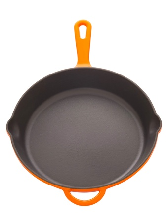 cooking utensils: close up of a cast iron pan isolated on white Stock Photo