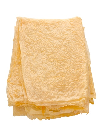 close up of a stack of beancurd sheets