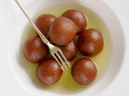 gulab: close up of indian dessert gulab jamun