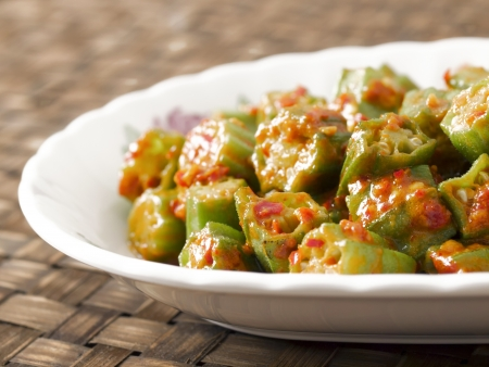 close up of a plate of stir fried okra in chili shrimp paste Stock Photo