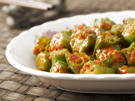 stir up: close up of a plate of stir fried okra in chili shrimp paste Stock Photo