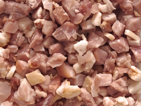 uncooked bacon: close up of uncooked bacon bits food background