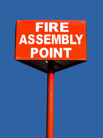 assembly point: close up of a fire assembly point sign