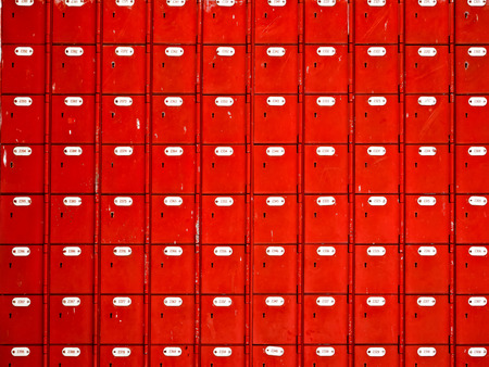 close up of rows of red mailboxes photo