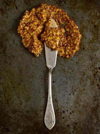wholegrain mustard: close up of rustic whole grain mustard Stock Photo