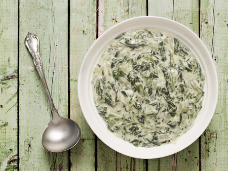 creamed: close up of a bowl of rustic creamed spinach
