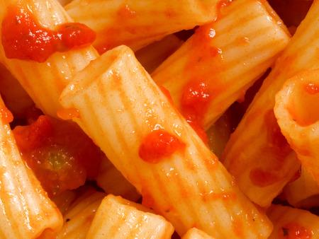 maccheroni: close up of maccheroni pasta in tomato sauce food background