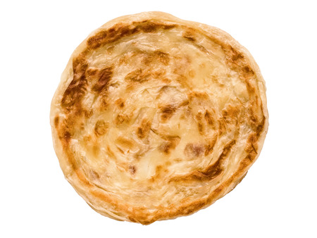 close up of an indian roti paratha fried pancake isolated