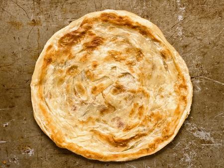 paratha: close up of rustic indian roti paratha fried pancake