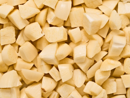 chunky: close up of chunky chopped uncooked raw garlic food background