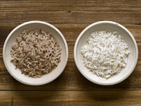 unpolished: close up of rustic cooked polished and unpolished rice