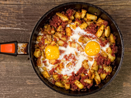 hash: close up of rustic minced corned beef  potato hash
