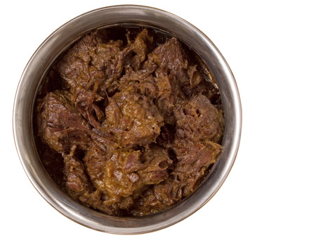 close up of a bowl of spicy beef rendang isolated photo