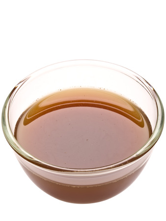 close up of a bowl of beef stock isolated