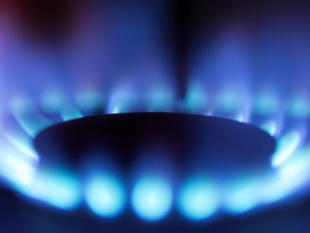 butane: close up of a gas stove blue flame