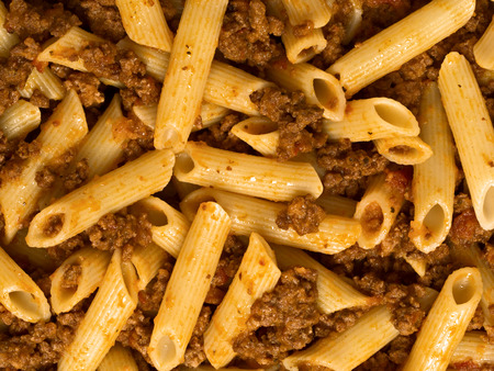 carbs: close up of  bolognese pasta food background Stock Photo