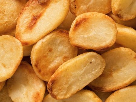 spud: close up of crispy roasted potato food background Stock Photo